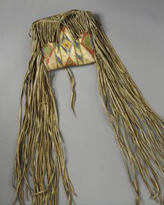 A CROW PAINTED HIDE PARFLECHE ENVELOPE    composed of buffalo hide and pigments.  Length with fringe 43 in.