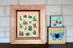 Succulents and butterflies prints. Terrariums art print by Andrea Lauren, Society6. Butterflies prints on recycled wood blocks.