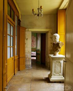 Golden ochre walls in Gerard Tremolet's Normandy Castle - Elle Decor