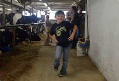 Cody Haag, 7, does an impromptu dance in his family's dairy barn.  | Reading Eagle - BERKSCOUNTRY