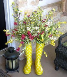 Rain Boots full of colorful blooms bring sunshine and spring to the porch of Twelve Oaks Manor.