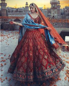 When the sun sets on her the twilight of her serenity shines...Wearing an imperial red lehenga she celebrates love !...