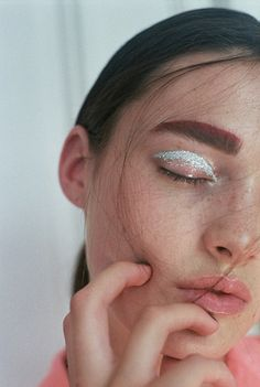 Colored brows and glitter lids. We spy some Acne Studios inspiration.