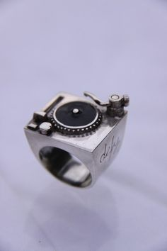 DJ Turntable Ring, $45.00 from DayDefyProject on Etsy -- for the record, I love this.