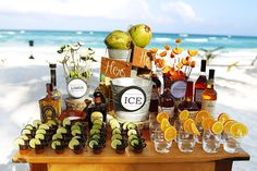 Wedding Tulum Akiin Beach Club, tequila and mezcal on the beach, great table set up with delicious refreshments that are typically Mexican! Mexico wedding photographers Del Sol Photography