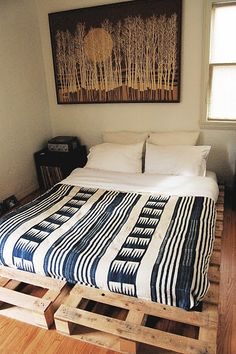 Avoid the metal mattress frame and make pallets your bed frame instead.