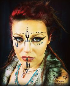 #katiesfunkyfaces Tribal Queen  Green, brown & black eye make-up with tribal face paint