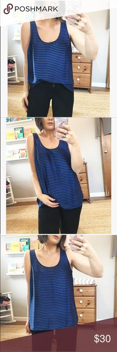 Michael Kors black and blue striped silky tank top Love this beautiful  silky black and blue sleeveless top from Michele Kors! Looks so cute with black denim.  Size XL true to size Great used condition Michael Kors Tops Tank Tops