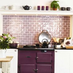 A purple-hued triple threat in an aubergine Aga stove, lavender tile backsplash (Marsh High Gloss Half Tiles from Residence range from the Winchester Tile Company), and plum kitchen accessories. Image via House to Home. Aga Kitchen, Kitchen Tiles, Kitchen Colors, Country Kitchen, Kitchen Dining, Kitchen Decor, Purple Kitchen Designs, Shaker Kitchen, Aga Stove