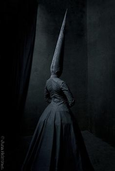 Juha Arvid Helminen unnerves with his Shadow People, a dreamily creepy series of black-on-black photos that evokes The Invisible Man and Silent Hill's Pyramid Head monsters. His black-wrapped subjects are amassing an army to march through your nightmares.