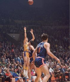 Jerry West of the Lakers launches a shot against the Knicks. West drained a dramatic, desperation as time expired in Game 3 to send things to overtime. The Lakers went on to lose that game and dropped the series to New York, Basketball Photos, Pro Basketball, Basketball Legends, Oscar Robertson, Nba Los Angeles, World Of Sports, Nba Players, Sports Illustrated, Finals