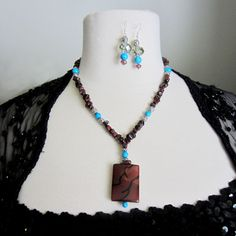 Clarity: This one of a kind Necklace set is made of Amber, Tiger eye, Turquoise and Silver.. $75.00, via Etsy.