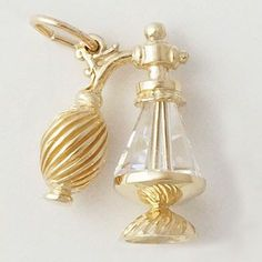 3 Dimensional Atomizer charm has a clear body with the top and bottom in your selected metal.