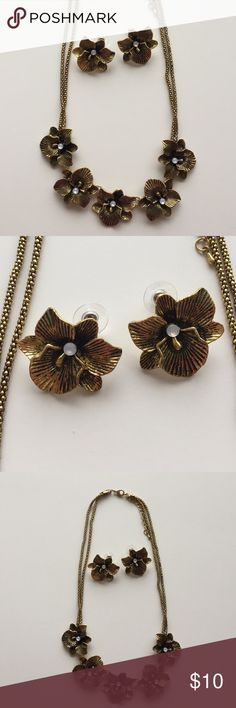 Floral Necklace & Earrings Set Gold tone floral necklace and earrings set has only been worn once. Great condition. Jewelry Necklaces