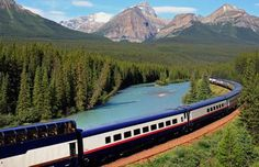 The Rocky Mountaineer tourist passenger train at Morant's Curve on the CPR line along the Bow River near Lake Louise in Banff National Park, Alberta, Canada. John E Marriott/All Canada Photos/Getty Images
