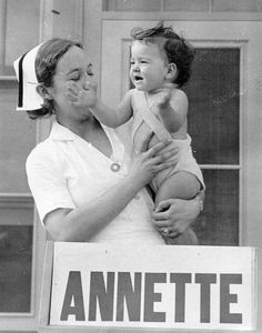 Annette Dionne being held up by a nurse for the public to see, around age one, Multiple Births, Conjoined Twins, Remembering Mom, Go Ride, Vintage Nurse, 5 Babies, Beautiful Little Girls, Infancy, Mirror Image