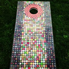 Corn hole board my friend made out of beer bottle caps. It also lights up so you can play in the dark!