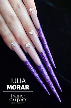 Stiletto nails with mettalic effect and crystals