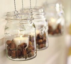 Acorns, mason jars, wire hangers.  These would look great hanging from the low tree branches at a backyard party!
