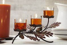 Seasonal showpiece is a nature-inspired arrangement of autumn leaves and acorns. Three glass cups for use with votives or tealights set the metal holder aglow. Candles sold separately. #PartyLite #candles