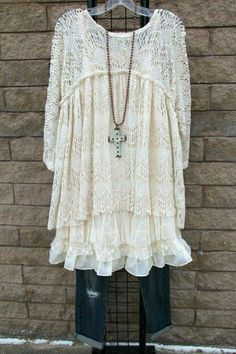 Lace tunic. Ditch the cross, it takes attention away from the tunic.