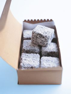 My lamington recipe makes a wonderfully light sponge covered in chocolate and coconut flakes.