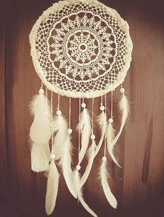beautiful white crocheted dream catcher with white feathers and white beads