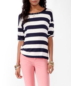 Navy and white cozy sweater with pink jeans and bling.