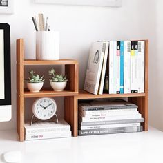 A wooden desk organizer to free up some desk space for napping when your all-nighter doesn't go as planned.