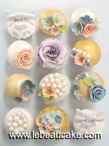 opac colored cupcakes with pearl and rose decoration I would make these my cousins tea party