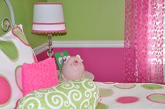 Love the lamp with pom pom trim and the sheer curtains.