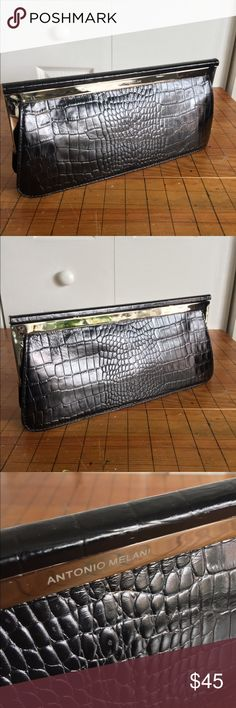 Antonio Melani black leather clutch Antonio Melani black leather clutch, silver details. Light use, some wear on the clasp--please see detail photo. Great for evenings out with your favorite LBD! ANTONIO MELANI Bags Clutches & Wristlets