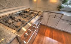 Industrial gas range in this high end, custom kitchen. www.jamesriverconstruction.com