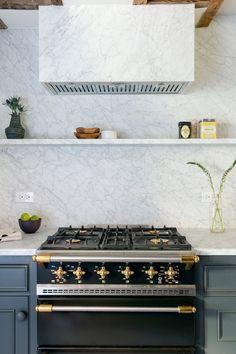 Carrara marble backsplash in the luxurious kitchen