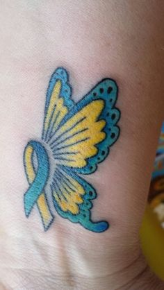 My new tattoo. Down syndrome ribbon and butterfly. Love it and love you Drew.