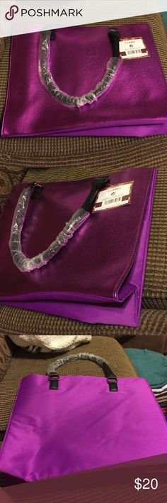 Purple Tote Bag This is a super cute purple tote bag. Never been used and no defects. Be great to use for a weekend trip to put all your essentials in! Bags Totes