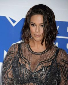 Ashley Graham opted to show off her curvaceous figure to perfection as she made an eye catching appearance in a shimmering see through dress that showed off her black bra, which helped flaunt some impressive cleavage and high waist knickers, which put her pert derriere on display, while walking the red carpet with her husband Justin Ervine at the 2016 MTV Video Music Awards held at Madison Square Garden on August 28, 2016 in New York City.