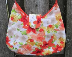 Handmade Purse with Long Shoulder Strap - Watercolor Floral. $20.00, via Etsy.
