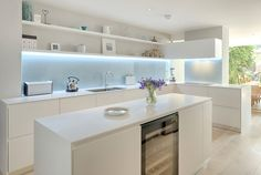 Kitchen in coloured satin matt lacquer with glacier white Corian worktop and back painted glass splashback by INTERIOR ID Glass Backsplash Kitchen, Glass Kitchen, Kitchen Tiles, New Kitchen, Kitchen Design, Kitchen Splashback Ideas, Kitchen White, Kitchen Furniture, Kitchen Interior