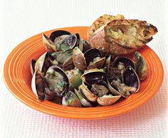 Grilled Clams with Lemon-Ginger Butter and Grilled Baguette    Read More http://www.epicurious.com:80/recipes/food/views/Grilled-Clams-with-Lemon-Ginger-Butter-and-Grilled-Baguette-354293#ixzz1o178C7uo