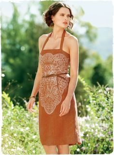 Lacy florals are stenciled in silver on our strapless papaya linen sheath. From Peruvian Connection