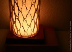 A hurricane lamp from paper towel roll segments designed by Patricia Zapata