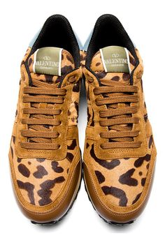 Panelled suede and calf-hair leopard print sneakers in tones of brown. Label tab at tongue. Brown smooth leather toe wrap. Brown suede panels at eyerow and upper toe wrap. Light blue leather heel tab. Green suede heel counter. Green studded rubber foxing detail at heel. Designed by Valentino. http://zocko.it/LDCBx