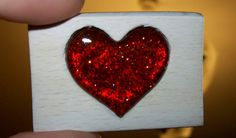Self-made wooden ornament with resin heart. It is made of oak wood and resin of spruces from forest.
