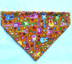 Love music? treat your dog to this guitar pattern bandana.  All sizes available at woofwebshop.co.uk from £4 #dogbandana #homemadebandanas #dogbandanasuk #guitars #musicalbandana