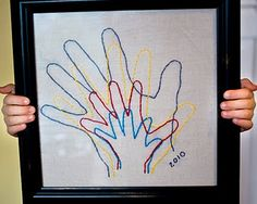 Christmas Gifts for Grandparents - trace handprints onto fabric and embroider