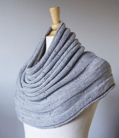 This reversible cowl is light as meringue! Knit top-down with fingering weight yarn in simple stockinette and reverse stockinette stitches with little eyelets. You will need a minimum of 420 - 520 yards of yarn for a cowl or a minimum of 840 - 1,100 yards of yarn for a deep cowl / small shoulder warmer. Keep knitting for a larger shoulder warmer! Instructions are included for two sizes: 20 inches and 22.50 inches neck circumference. Blocking required.Cowl: 20 / 22.50 inches neck…