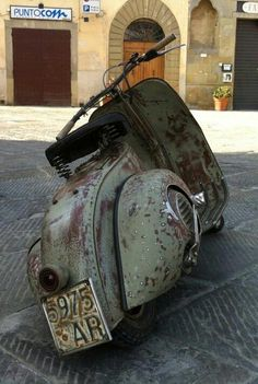 Vespa - Editor's Note: I really Love this one the best! It looks like it's been around the globe at least once!