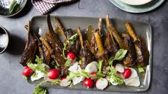 These lamb ribs are darkly sticky and delicious, and perfect for entertaining a crowd. The treacle and miso enrich and add depth of flavour to the ribs, while the vinegar cuts through the fat. There's no need to marinate these. You'll get super intense flavour as the ingredients cook down and meld in the oven. You could also use pork ribs.