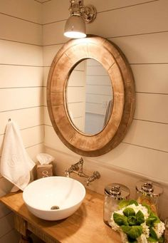Love the planking with the round drift wood mirror...bit small though.